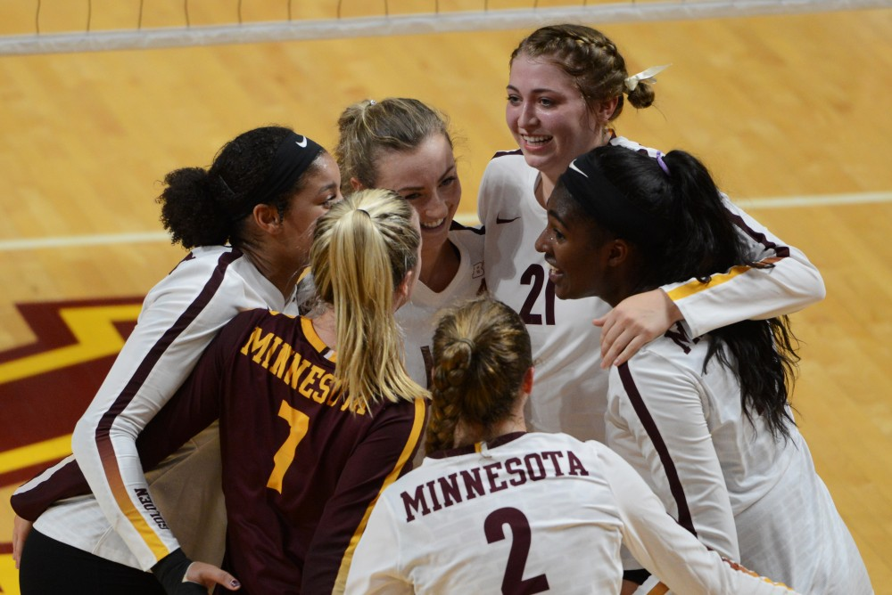 Gopher volleyball players celebrates earning a point on Sept. 13 during the game against Green Bay at Maturi Pavilion.