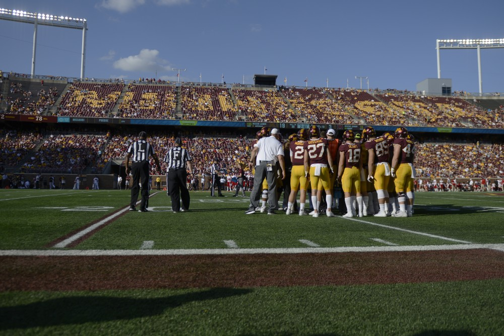 The Gopher football team huddles during a time out on Saturday, Sept. 15 at TCF Bank Stadium in Minneapolis.