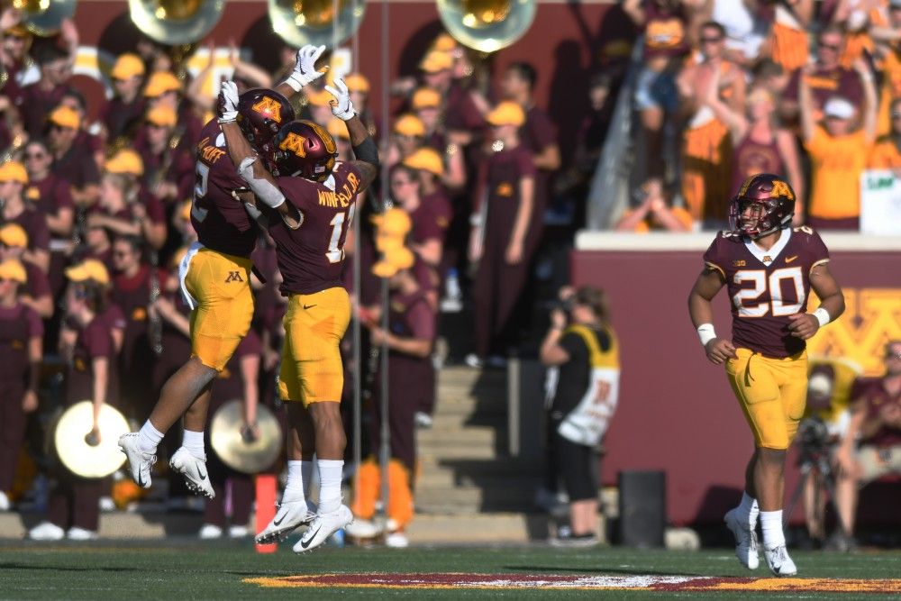 Jacob Huff and Antoine Winfield Jr. celebrate after a touchdown on Saturday, Sept. 15 at TCF Bank Stadium in Minneapolis.