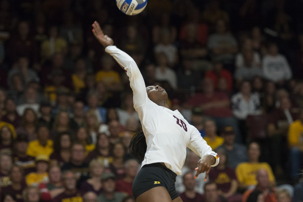Outside Hitter Adanna Rollins jumps to hit the ball at the Maturi Pavilion on Wednesday, Sept. 19.