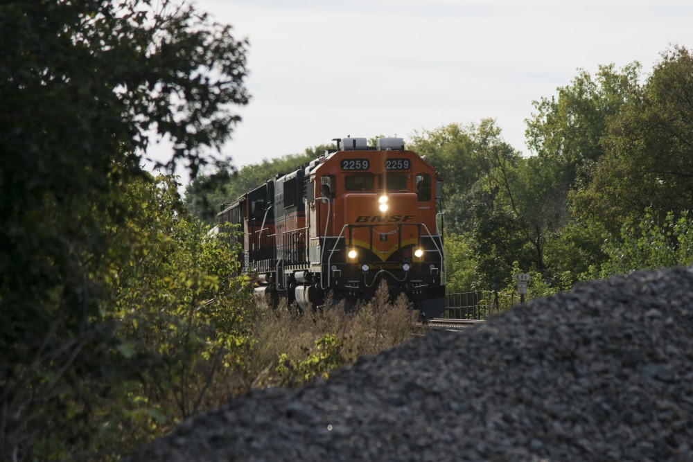A BNSF Railway Company freight train passes by an unofficial railroad crossing in Como on Monday, Sept. 24. Despite a death last October and an injury at the site in August, neither the city nor BNSF has put up a fence or more signs that encourage safety.
