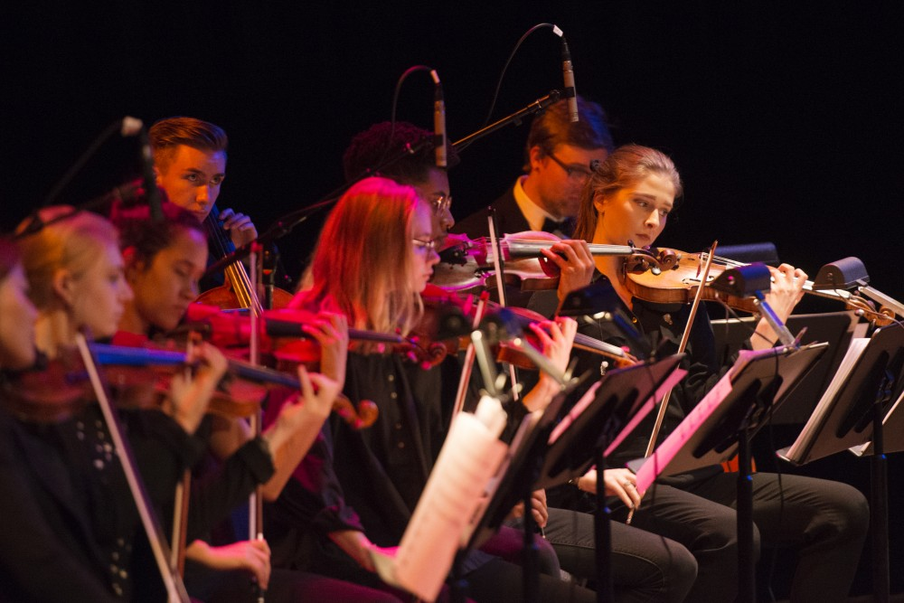 The chamber strings from the University Symphony Orchestra backed up St. Paul and the Minneapolis Funk All Stars as they opened for the ceremony for honorary Doctor of Humane Letters degree to Prince at Ted Mann Concert Hall on Wednesday, Sept. 26. An honorary degree is the highest award conferred by the University of Minnesota, recognizing achievements that have added to the betterment of society.