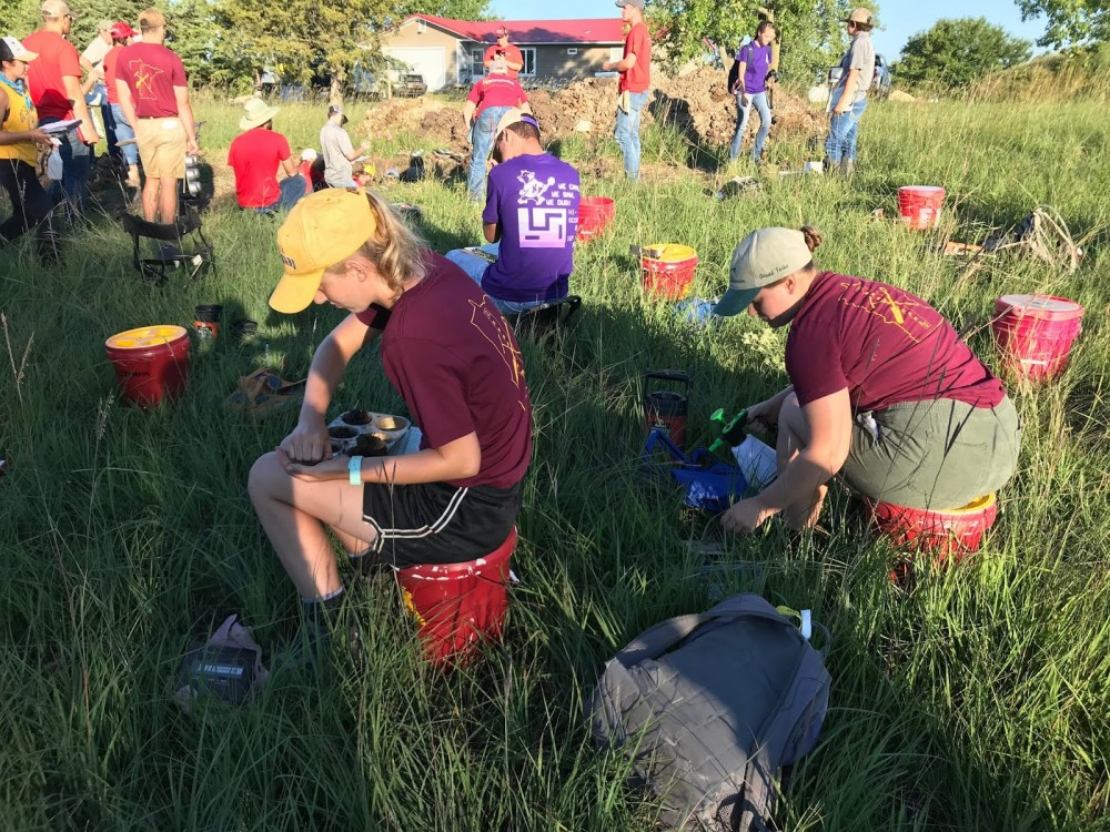 Autumn Boxum and Harley Braun, members of the University's soil judging team, work on texture samples.