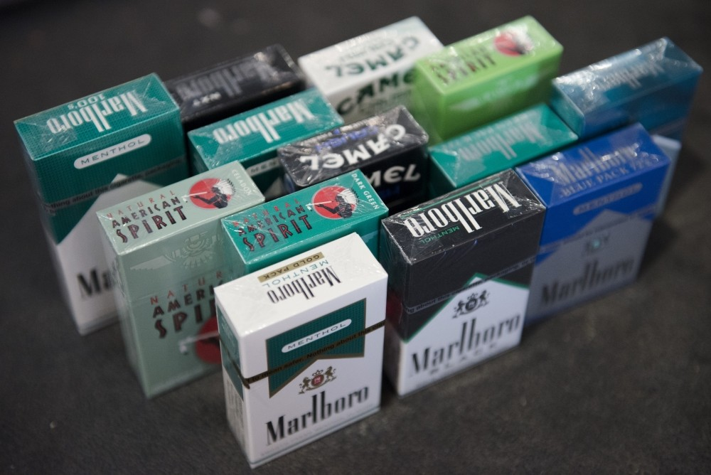 A variety of menthol cigarettes are displayed on a stand at Hideaway smoke shop in Dinkytown on June 18.