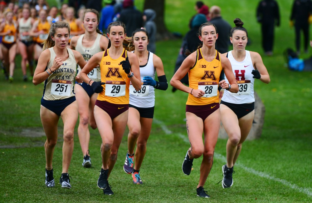 Bethany and Megan Hasz run side by side at Les Bolstad Golf Course on Saturday, Sept. 29, 2018.  The Hasz twins finished first and second overall for Gopher women