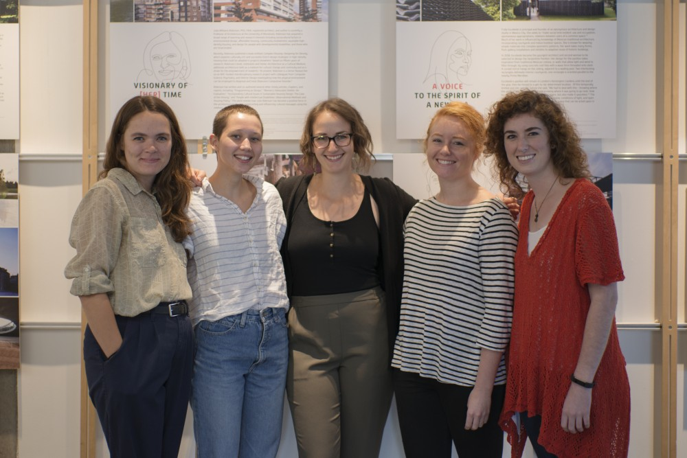 Mary Begley, Dana Saari, Erin Kindell, Brit Lindsay, and Neva Hubbert members of Women in Architecture Student Organization, or WiASO, pose for a photo in front of their exhibit,