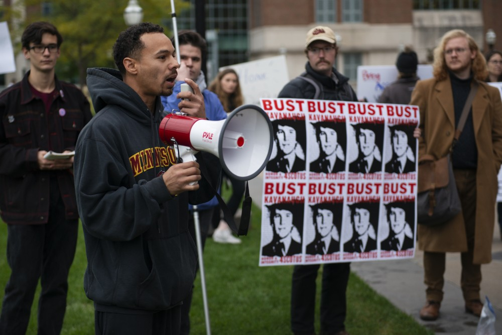 Todd Gramenz addresses the crowd at a demonstration put on by Students for a Democratic Society. The event, held on Thursday, Oct. 4 outside of Coffman Memorial Union, opposed Brett Kavanaugh's nomination to the Supreme Court.
