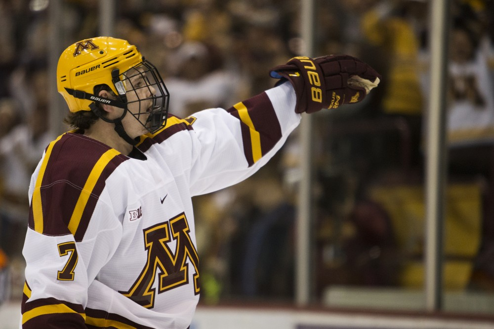 Sophomore forward Brannon McManus celebrates his second goal of the game against the University of Minnesota Duluth on Sunday, Oct. 7 at Mariucci Arena.