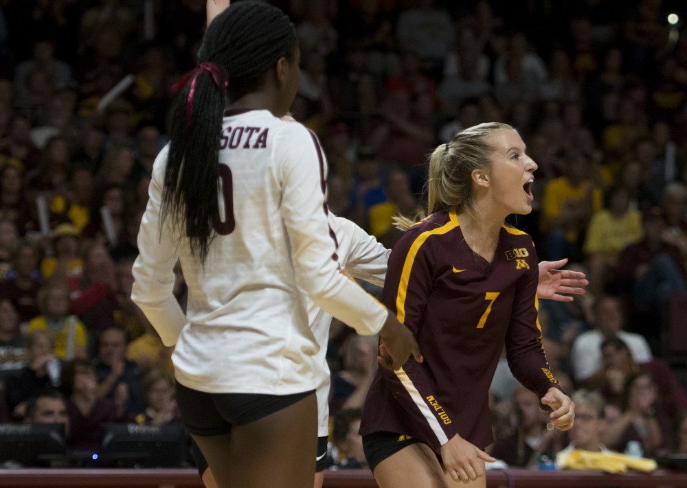 CC McGraw celebrates a scored point at the Maturi Pavilion on Wednesday, Sept. 19. They defeated Penn State for their Big Ten opener in straight sets.
