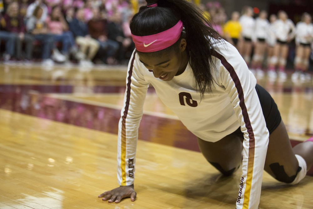 Sophomore opposite hitter Stephanie Samedy gets up from the floor after diving for the ball during the game against the Northwestern Wildcats on Saturday, Oct. 13, 2018. The Gophers beat Northwestern in all three sets.