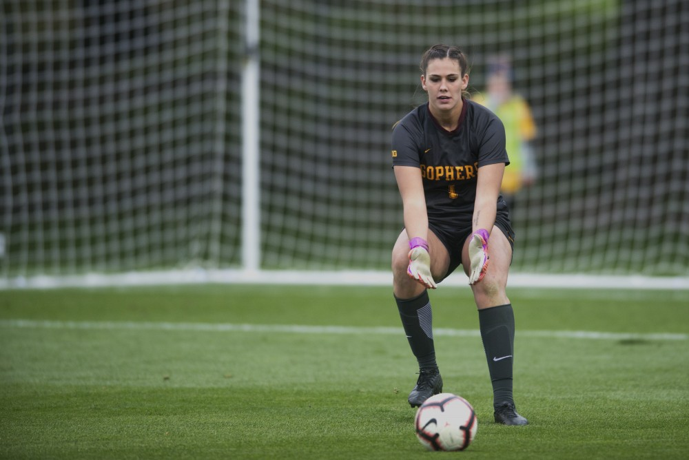 Goaltender Maddie Nielsen picks up the ball. Gopher women's soccer lost to Wisconsin 3-2 at Elizabeth Lyle Robbie stadium on Saturday, Oct. 13, 2018.