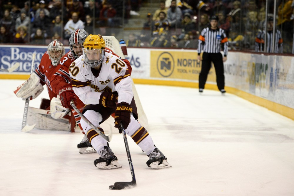 Ryan Zuhlsdorf handles the puck on Friday, Feb. 16, 2018 at 3M Arena at Mariucci in Minneapolis.