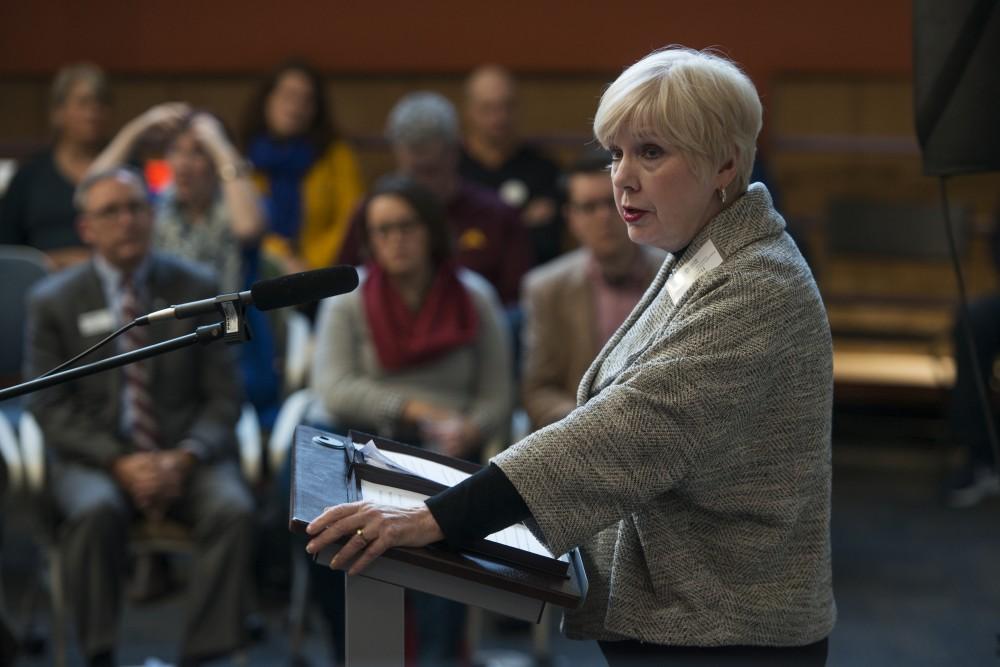 Provost Karen Hanson addresses the opening of the