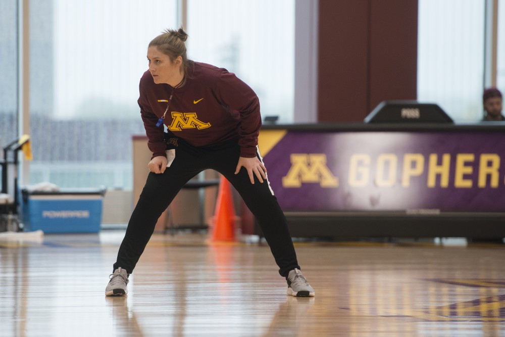 Coach Lindsay Whalen watches a play intently at the Gopher women's basketball practice on Monday, Oct. 9, 2018 in the Cunningham Basketball Performance Center.