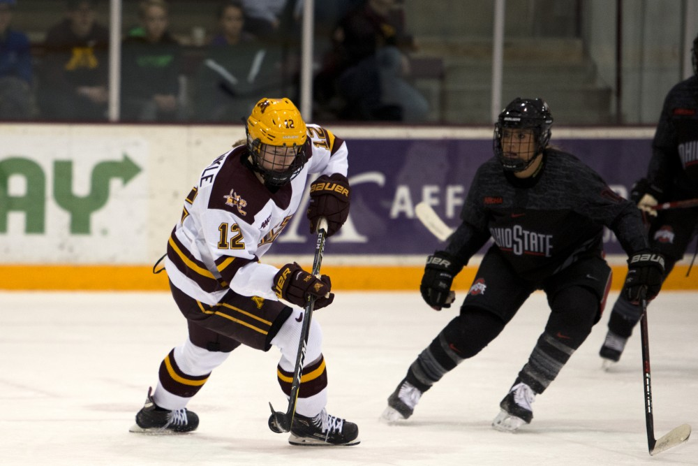 Forward Grace Zumwinkle looks to pass the puck at Ridder Arena on Friday, Oct. 19. The Gophers beat Ohio State 3-0.