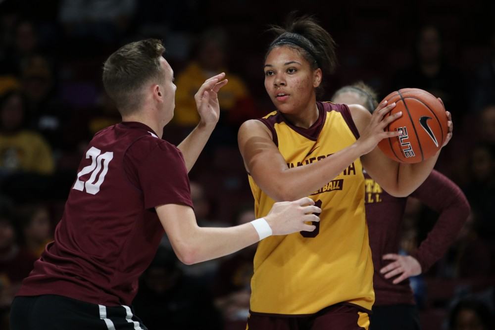 Guard Destiny Pitts looks for her next pass during Gopher women's basketball's annual exhibition versus the men's scout team on Saturday, Oct. 20 at Williams Arena.