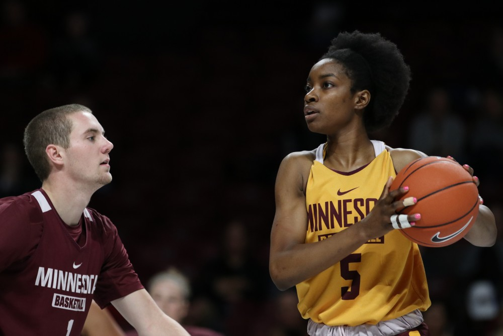 Forward Taye Bello looks up court during Gopher women's basketball's annual exhibition versus the men's scout team on Saturday, Oct. 20 at Williams Arena.