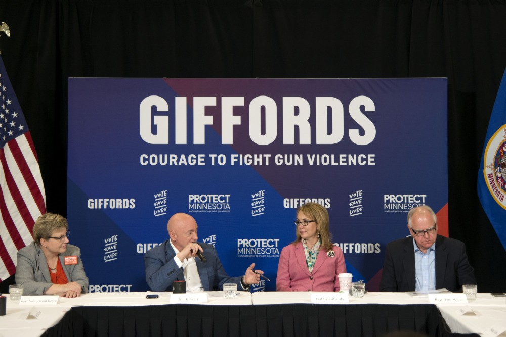 Captain Mark Kelly, center left, engages in a round table conversation as part of Gabby Giffords,' center right, Courage to Fight Gun Violence Campaign at the Graduate Hotel on Friday, Oct. 26.