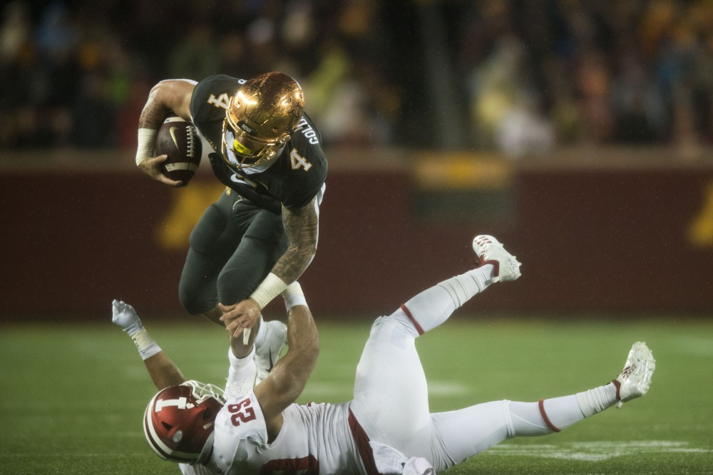 Senior Shannon Brooks works to avoid a tackle from Indiana on Friday, Oct. 26 at TCF Bank Stadium.