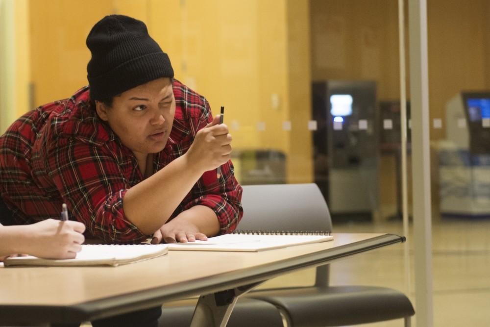 University of Minnesota senior Caytlin Neuburger teaches an art class at Central Library in downtown Minneapolis, Wednesday, Oct. 10, 2018. Neuburger studies Communications Studies and Studio Art.