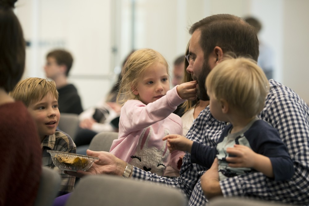 Charlotte Paulsen feeds her dad, Andrew, a cricket based chip on Sunday, Oct. 7. as part of Food Fest at the newly opened Bell Museum in Saint Paul. Sujaya Rao's presentation, which examined bugs as a sustainable source of protein, encouraged the audience to try samples.