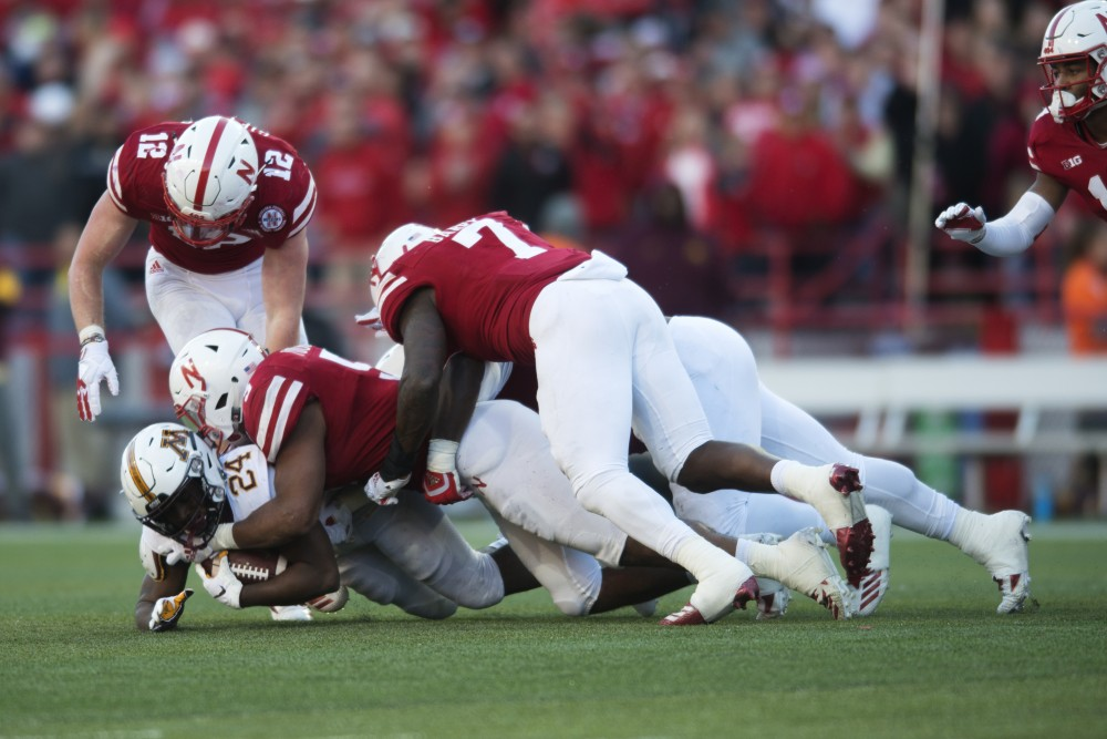 Running back Mohamed Ibrahim gets tackled by Nebraska on Saturday, Oct. 21, 2018 at Memorial Stadium in Lincoln, Nebraska.