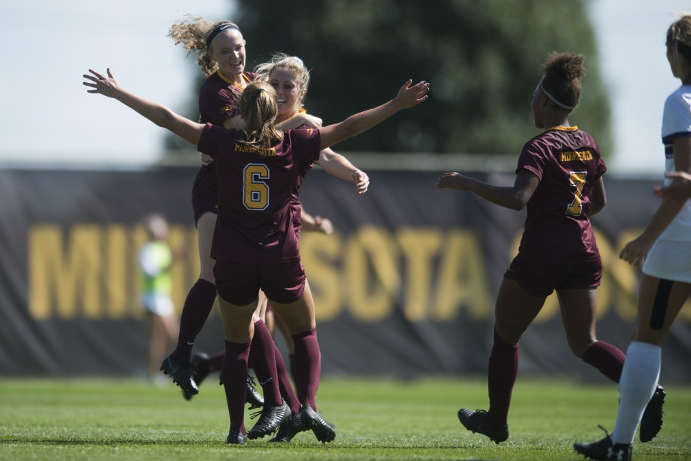 Gophers April Bockin, Emily Peterson and Molly Fiedler celebrate a penalty kick scored by Bockin at Elizabeth Lyle Robbie Stadium on Sunday, Sept. 16, 2018.