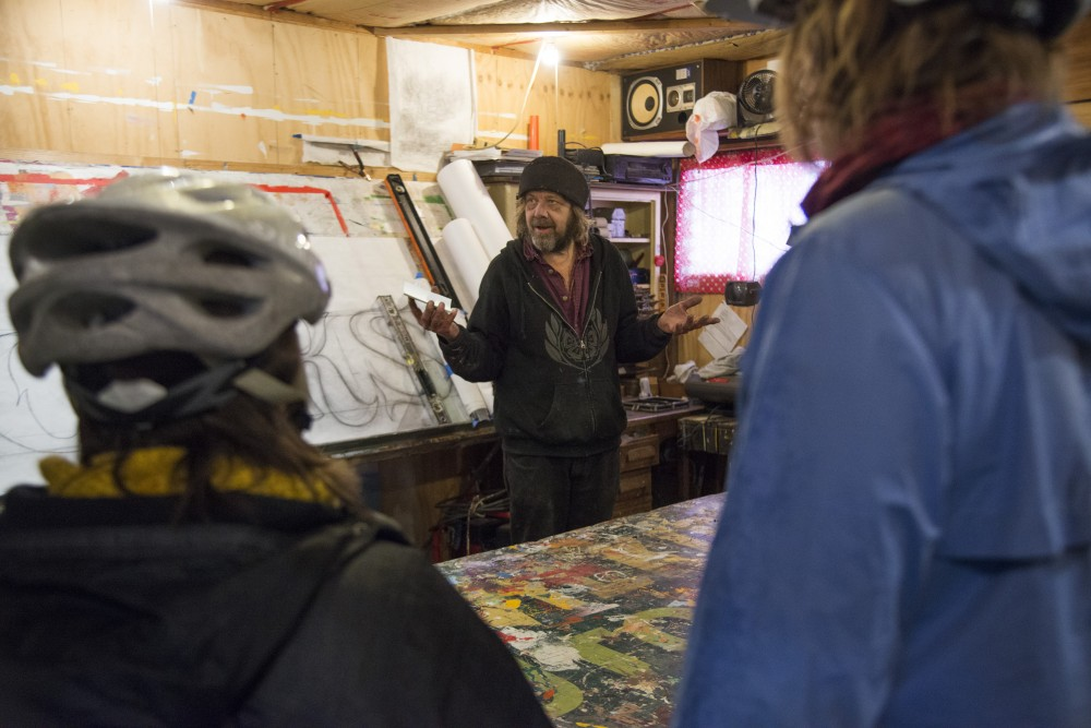 <p>Phil Vandervaart talks about his street art before the alley ride hosted by the Minneapolis Alley Initiative for Neighborhood Stimulation on Sunday, Nov. 4. A map of the ride, which features public art in the Longfellow & Powderhorn neighborhoods, can be found online. </p>