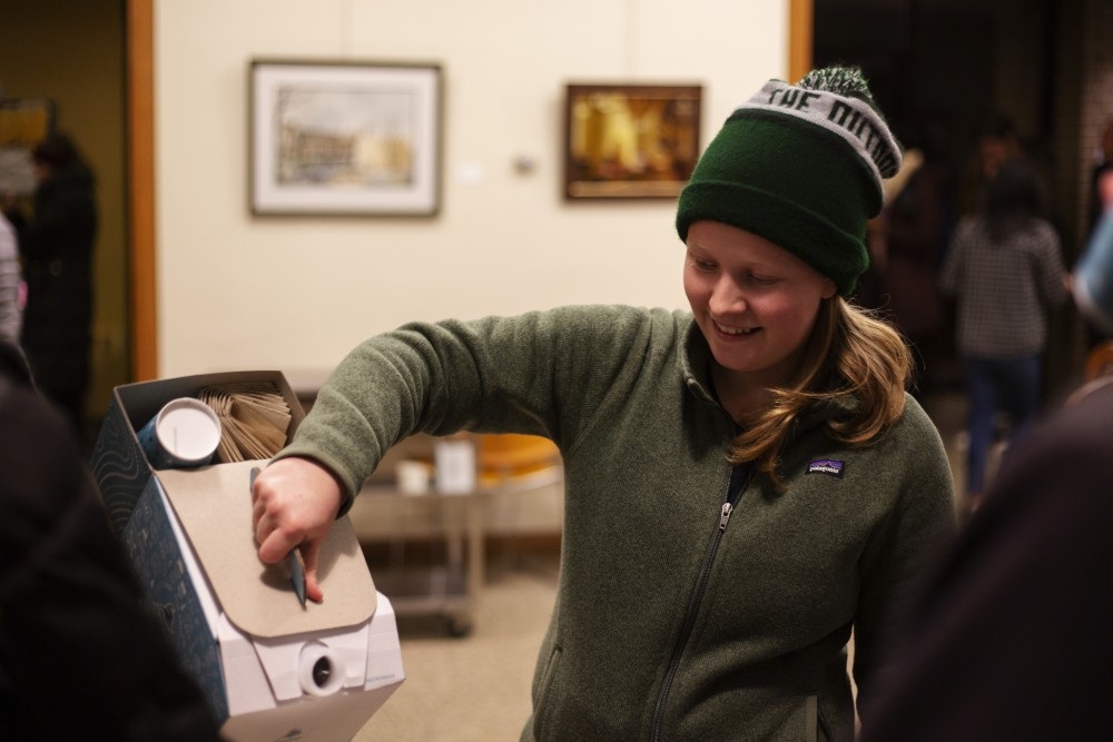 Saint Louis Park High School Student Ellen Polter pours coffee for voters waiting in line at the University Lutheran Church polling place on Tuesday, Nov. 6 in Dinkytown. She came with the DFL party, and said she was there to make sure people stayed in line. Polter said the party sent volunteers like her around to use their surplus of campaign donations to keep voters in long lines.