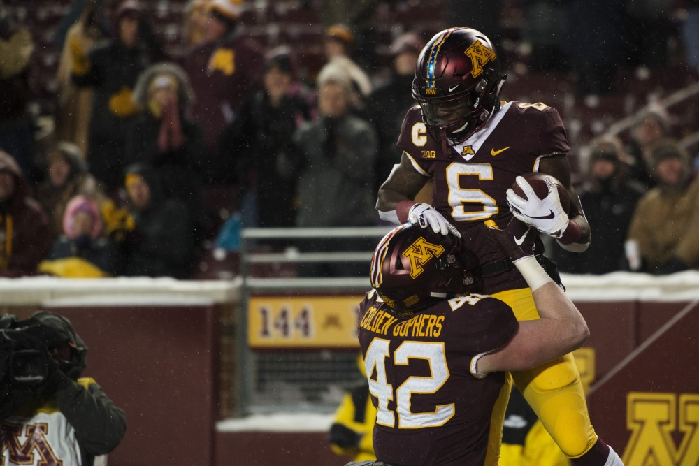 Tight End Ko Kieft lifts up Wide Receiver Tyler Johnson after his second half touchdown on Saturday, Nov. 10 at TCF Bank Stadium. The Gophers beat Purdue 41-10. Johnson ended the game with 73 receiving yards and one touchdown.