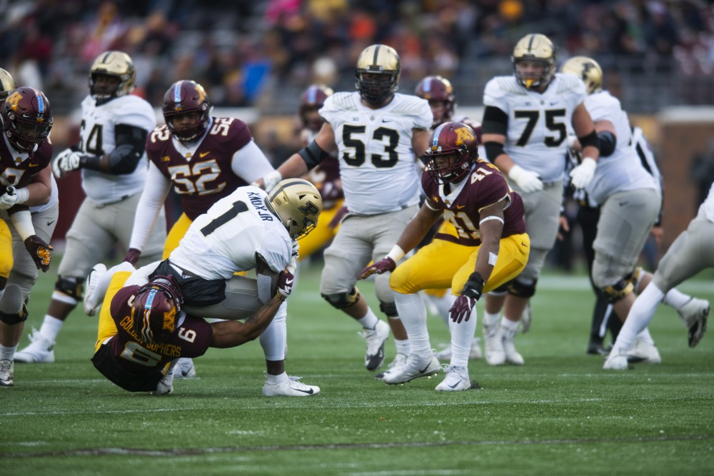 <p>Defensive back Chris Williamson tackles Purdue during the game on Saturday, Nov. 10 at TCF Bank Stadium. The Gophers beat the Boilermakers 41-10.</p>