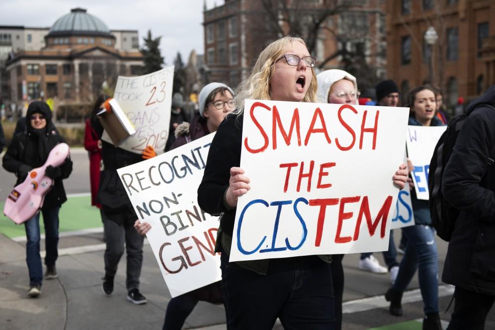 Former University of Minnesota student Luna Brekke marches across campus in support of transgender rights on Thursday, Nov. 8.