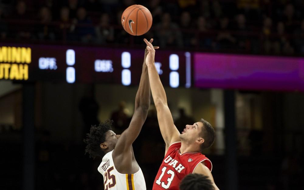 Freshman Daniel Oturu takes the jump ball at the beginning of the game on Monday, Nov. 12, 2018 at Williams Arena. The gophers beat Utah 78-69.