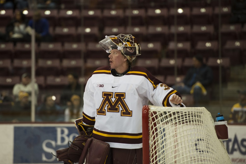 Goaltender Eric Schierhorn takes a water break at Mariucci Arena on Saturday, Nov. 17. The Gophers beat the St. Lawrence Saints 3-0.