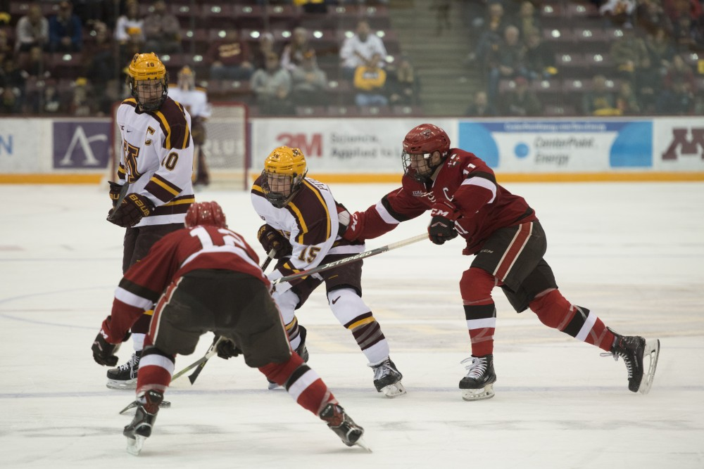 Junior Rem Pitlick battles two defenders at Mariucci Arena on Saturday, Nov. 17. The Gophers beat the St. Lawrence Saints 3-0.
