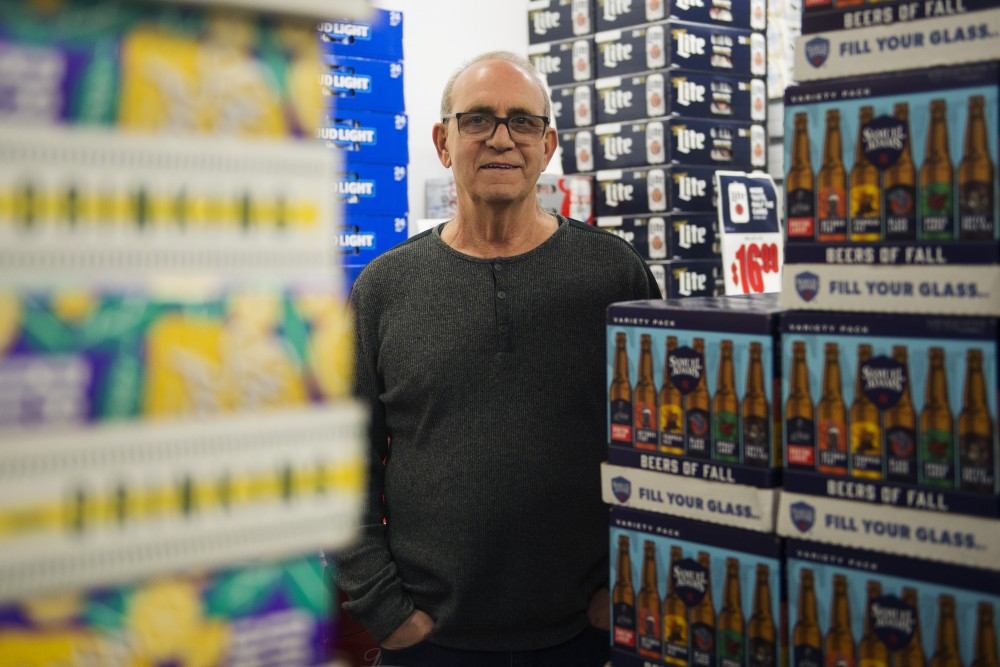 Dinkytown Wine and Spirits owner Irv Hershkovitz poses for a portrait inside of his liquor store on Tuesday, Nov. 20. The store, which opened in 1990, is not the first business Hershkovitz has operated in the area.