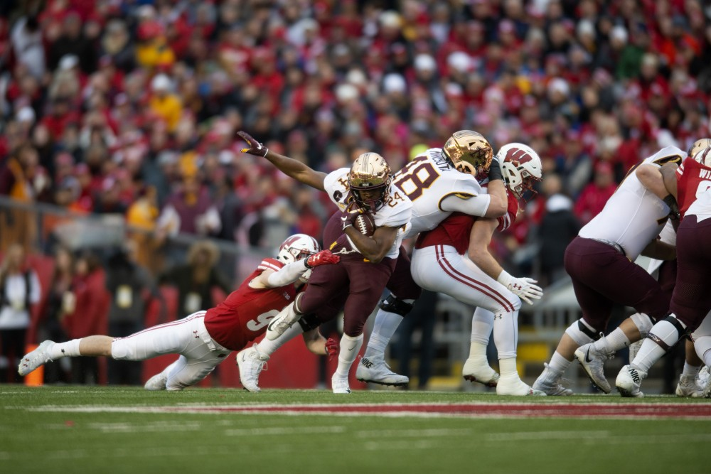 <p>Runningback Mohamed Ibrahim breaks a tackle at Camp Randall Stadium in Madison on Saturday, Nov. 24. The Gophers beat the Badgers 37-15 for the first time since 2003. Ibrahim finished the game with 121 yards and a touchdown.</p>