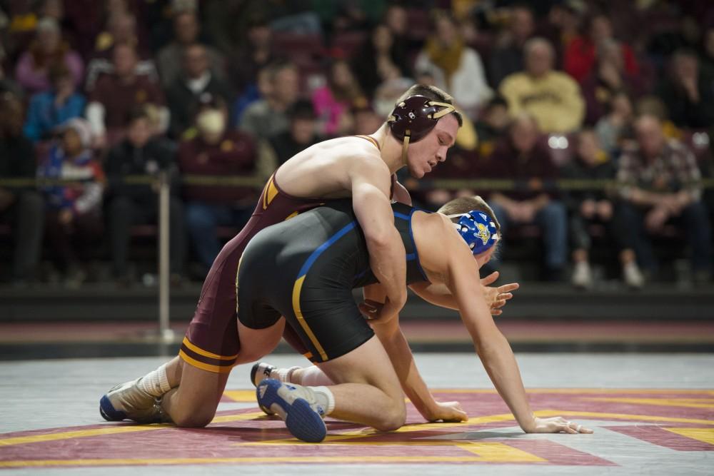 Freshman Mitch McKee at 125 competes during the match against South Dakota State on Sunday, Nov. 25 at Maturi Pavilion.