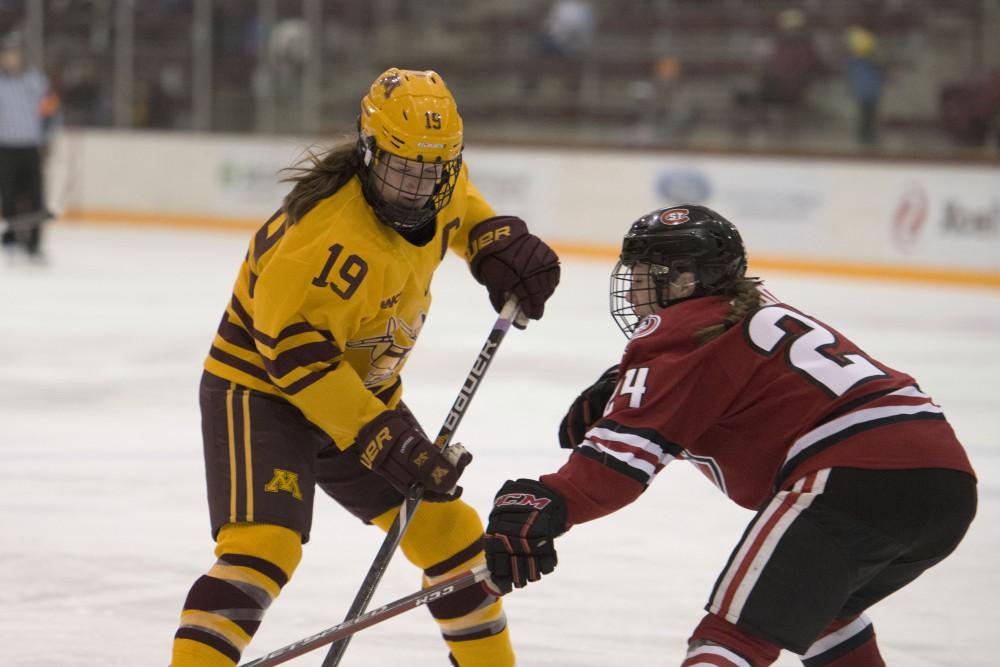 Redshirt senior Kelly Pannek fights for the puck on Sunday, Nov. 18 at Ridder Arena.