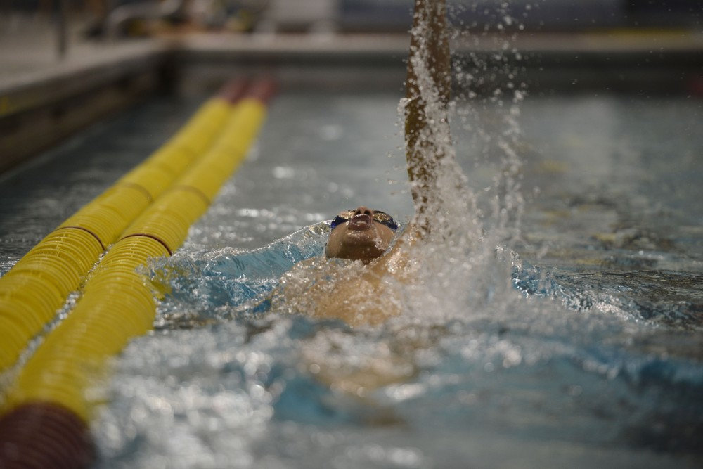 Junior Erik Hunter competes in the 200 Yard Backstroke race during the Minnesota Invitational on Saturday, Dec. 2, 2017 at the Jean K Freeman Aquatic Center.