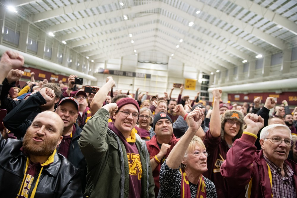 Gopher fans convene late into the evening of Saturday, Nov. 3 at the football team's indoor practice facility to greet the team as they returned from their win in Madison, Wisconsin. The Gophers defeated the Badgers the first time since 2003.