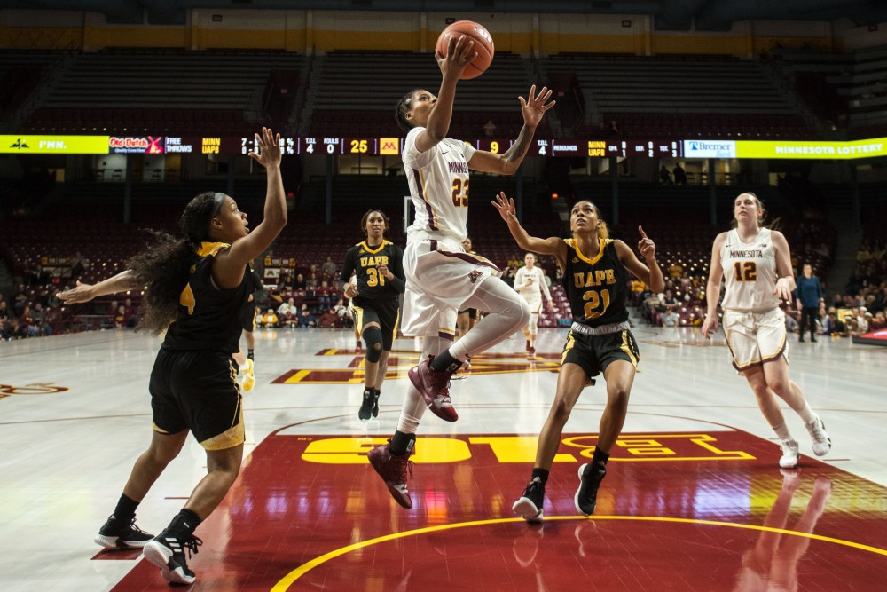 Senior Kenisha Bell lays the ball in at Williams Arena on Tuesday, Nov. 20. The Gophers beat the Arkansas-Pine Bluff Golden Lions 84-42. Bell finished with 24 points.