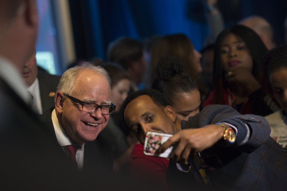 Newly-elected Governor of Minnesota Tim Walz takes a selfie with a supporter at Intercontinental Saint Paul Riverfront Hotel in Saint Paul on Tuesday, Nov. 6.
