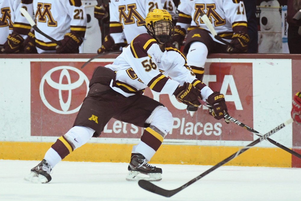 Freshman Sampo Ranta fights for the puck on Friday, Nov. 30 at Mariucci Arena.