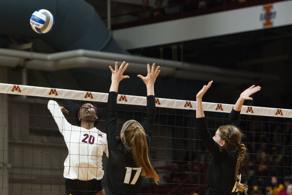 Outside hitter Adanna Rollins jumps to spike the ball at Maturi Pavilion on Friday, Nov. 30. The Gophers swept Bryant three sets to none as a start to their postseason.