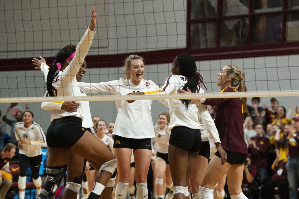 The Gophers celebrate a sweep over Bryant to start their postseason at the Maturi Pavilion on Friday, Nov. 30.