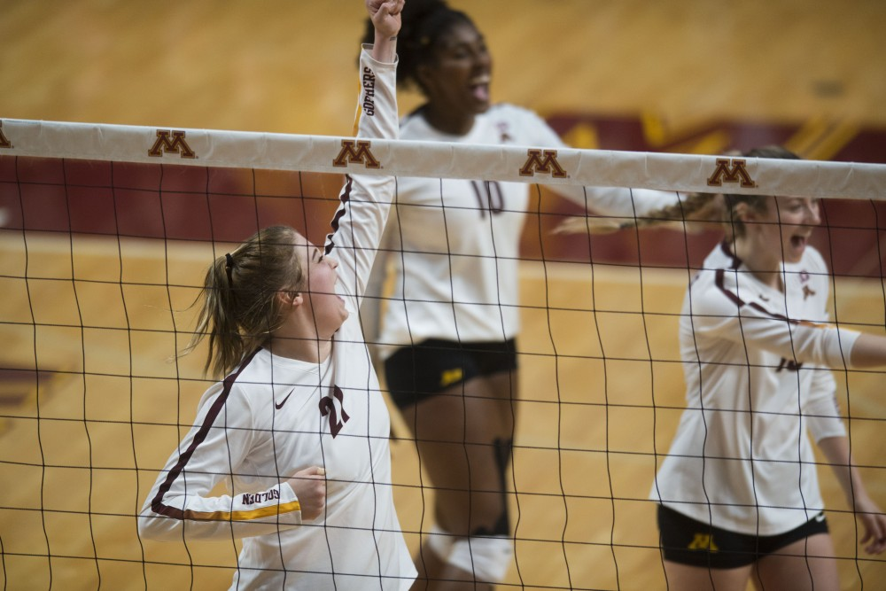 Redshirt sophomore Regan Pittman celebrates a point earned with her team at Maturi Pavilion on Saturday, Dec. 1. The Gophers swept South Carolina in all three sets.