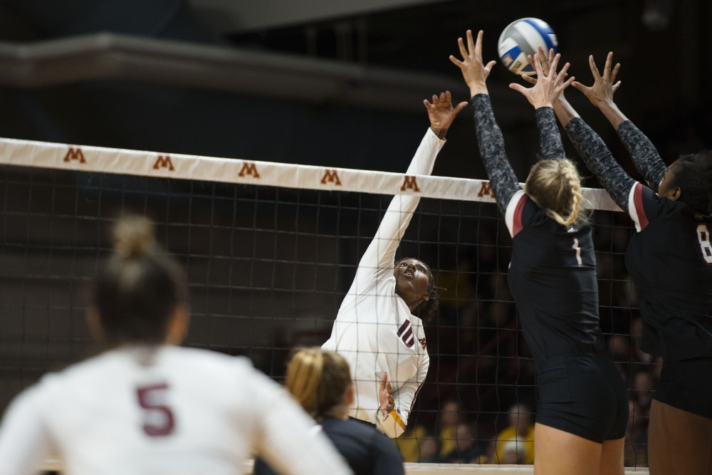 Outside hitter Stephanie Samedy spikes the ball at Maturi Pavilion on Saturday, Dec. 1, 2018. The Gophers swept South Carolina in all three sets.