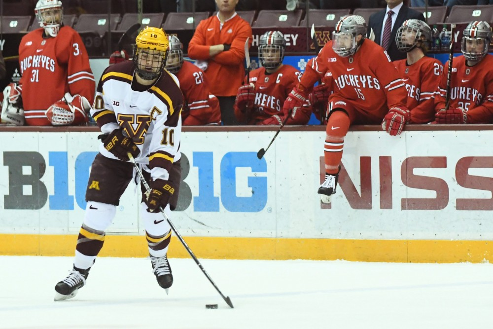 Senior Brent Gates Jr. skates with the puck during the Gopher game against Ohio State on Friday, Nov. 30, 2018 at Mariucci Arena.