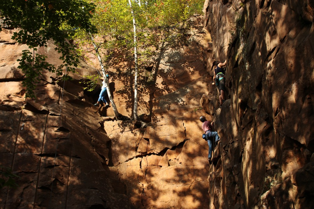 Climbers ascend a route on Sept. 15 at Robinson Park in Sandstone, Minnesota.
